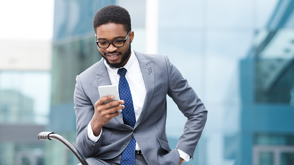 businessman on mobile phone in front of building
