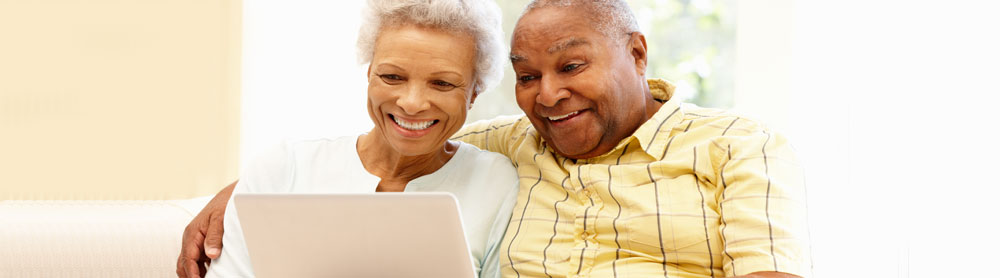 elderly couple using laptop
