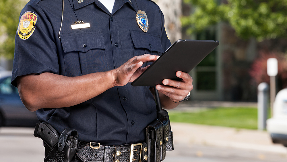 police officer using tablet
