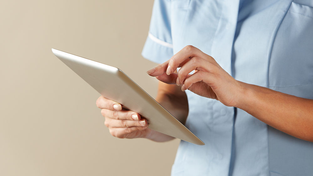 Nurse holding tablet