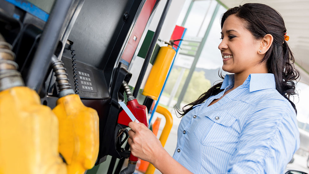 oil-and-gas-wm-card-woman-at-gas-station