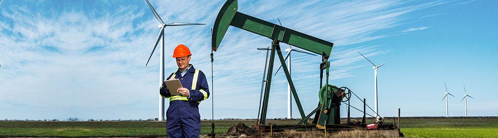 Man with tab - Oil and gas
