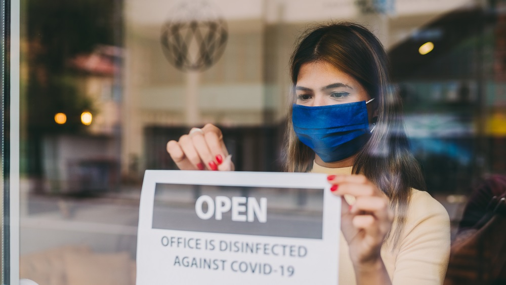 woman reopens business during covid-19