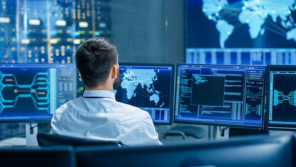 man monitors satellite data