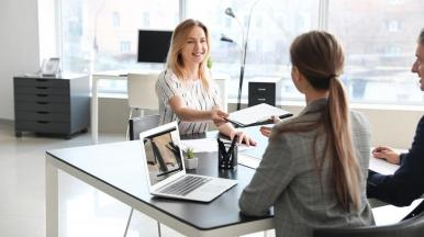 human resources interviewing woman in office