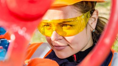Worker wearing orange goggles and a hard hat