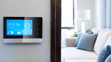 Smart thermostat outside white room