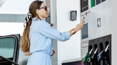 A person pays for fuel at a petrol pump