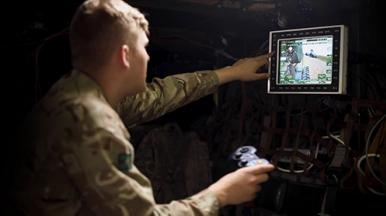 Soldier using a control looking at a screen