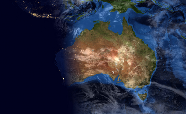 Australia at night representing critical national infrastructure seen from a satellite orbiting in space
