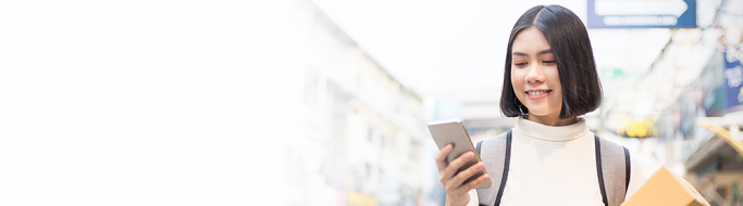 Woman with mobile - Greater value agility growth retail