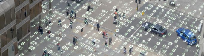 High angle shot of a London street overlaid with matrix style changing numbers.