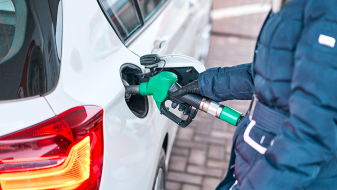 Fuel retail customers puts fuel into vehicle