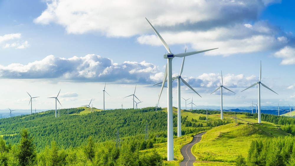 Wind turbines on a mountain range - CGI CSR 2020 Report